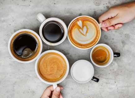 six white ceramic mugs